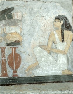 WALTERS: Egyptian: Woman Kneeling Before an Offering Table -1462