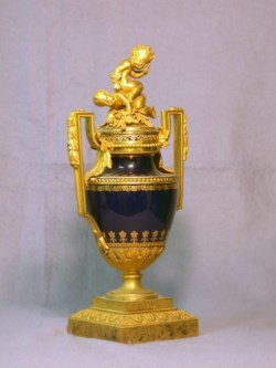 WALTERS: Sèvres Porcelain Manufactory (French, active 1756-present): Urn with Ormolu Mounts and Two Putti 1782