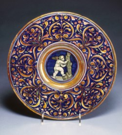 WALTERS: Workshop of Giorgio Andreoli (Italian, ca. 1465/1470-1555): Plate with Cupid Climbing a Tree 1513